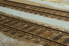 Rail road tracks. Two diagonal rail road tracks Stock Photos