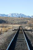 Rail Road Tracks Vertical. Santa Fe Railroad tracks in rural New mexico turning northward with the Sierra Ladrones mountain in the distance stock photography