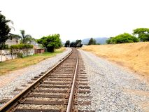 Rail Road Train Tracks Perspective Vanishing Point 2. Other side of the train tracks with a perspective vanishing point into the distance Stock Photo
