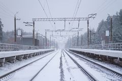 Rail road winter. Scary landscape with rail road in winter royalty free stock image