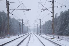 Rail road winter. Scary landscape with rail road in winter stock photos