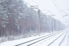 Rail road winter. Scary landscape with rail road in winter royalty free stock photography