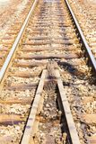 Rail rode. Rail transport is a means of transferring of passengers and goods on wheeled vehicles running on rails, also known as tracks stock photos