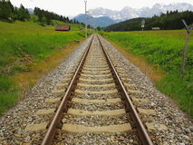 Straight railroad line to mountains Royalty Free Stock Image