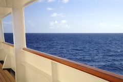 Rail by the Sea. The ocean is viewed from the rail of a cruise liner stock photos