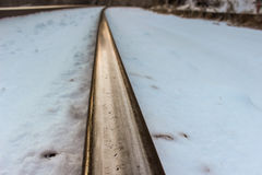 Rail in the Snow Stock Photo