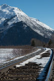 Rail and snowy mountain Royalty Free Stock Image