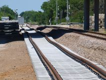 Rail Spur for Materials. A Texas DOT storage yard for barriers and related items gets a new rail spur to take delivery or ship out items left after a highway stock images