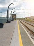 Rail station. Empty european platform at the rail station Stock Photography