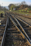 Rail switches in nature. Tracks for train trips and railway sleepers Stock Images