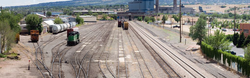 Rail switchyard panorama. True panorama of the tracks and switches found in a railroad switchyard in the middle of a city in central Colorado Stock Images