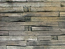 Rail Ties Wall. A rustic weather beaten wall built of old rail ties royalty free stock photography