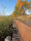 Rail at the time of autumn and the direction of the mountains. Stock Photo