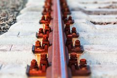 Rail track. Creative abstract railway transportation industry and railroad cargo shipping business infrastructure industrial concept: macro view of metal train Stock Image