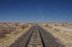 Rail track into desert. Straight rail track into the deep desert royalty free stock images