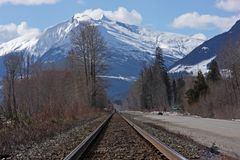Rail track with mountains stock images