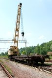 A Rail Track Mounted Crane. Old Rail Track Mounted Crane with blue sky on background stock images