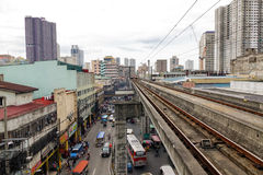 Rail track with the street in Manila, Philippines Stock Images
