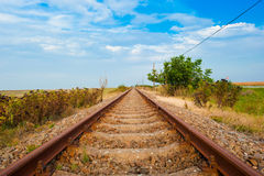 Rail tracks. Photo of an out of use part of rail tracks running into the distance in Vojvodina, Serbia, near Belgrade Stock Photos