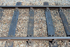 Rail Tracks Close-up. Railway track close up horizontally with wear and rust Royalty Free Stock Photos