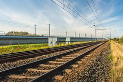 Rail tracks on concrete sleepers and basalt gravel in the Nether. Rail tracks on sleepers and basalt gravel in the Netherlands. The photo was taken on a sunny royalty free stock images