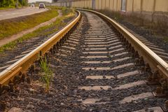 Rail tracks in the green field. Royalty Free Stock Photography