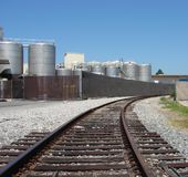 Rail tracks leading to Industrial plant Stock Photos