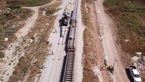 Railroad workers repairing a broken track. Repairing railway. Rail tracks maintenance process.