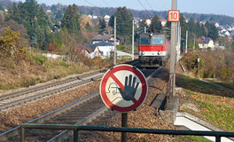 Rail-tracks, motor coach and sign forbidden passage. At the Austrian western railway, Austria stock photography