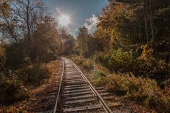 Rail Tracks toward bright sun Royalty Free Stock Photos