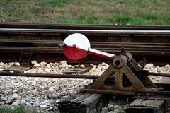 Rail and the train stops at the next.  Stock Photography
