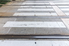 Rail of the tram lean together with crosswalk Royalty Free Stock Photography