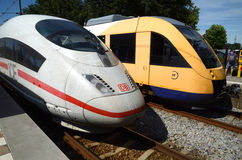 Rail transport in the Netherlands. Two locomotives for the Dutch station - IC Deutsche Bahn and regional yellow Dutch train Royalty Free Stock Photos