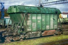 Rail transportation of different goods. Cars of train in summer royalty free stock photography