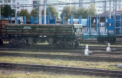 Rail transportation of different goods. Cars of train in summer stock photos