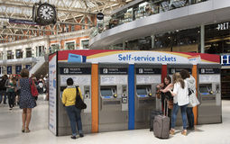 Rail travellers buying tickets Royalty Free Stock Photos
