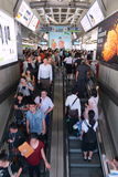Rail Travellers Pass Through A Train Station. Rail travellers pass through a BTS Skytrain station during rush hour on June 4, 2014 in Bangkok, Thailand. Launched Stock Image