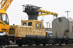 Rail trolley. Railway trolley with a crane standing on the station Royalty Free Stock Images