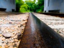Rail utilisé par moitié Image stock