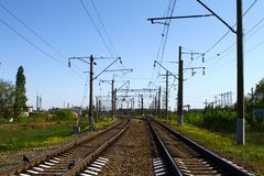 Rail way on country side in summer with a lot of electric poles on it sides on blue sky background. Rail way on country side in summer with a lot of electric royalty free stock photos