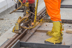 Rail worker grinding tramway track Royalty Free Stock Images