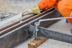 Rail worker tightening a bolt using wrench 2 Stock Image