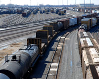 Rail yard. Railroad tracks and rail cars royalty free stock image