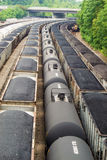 Rail Yard with Coal Hopper and Tank Railcars. Roanoke, VA – June 11: A vertical image of a Norfolk and Southern rail yard with coal hopper and tank royalty free stock photography