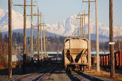 Rail Yard and Snow Capped Mountain Range Stock Image