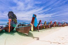 Railay beach with colorful long tail boats in Krabi, Thailand. In beautiful sky day Stock Image