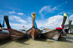 Railay Beach, Krabi, Thailand. KRABI, THAILAND – DEC 5, 2015: long-tailed boats for tourists are docked along the Railay Beach which is one of the most Stock Images