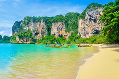 Railay Beach, mogotes, long tail boats in Thailand Royalty Free Stock Photography