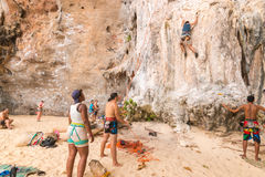 RAILAY, THAILAND - May 4, 2016: Rock climbers climbing the wall Stock Photos