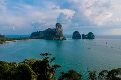 Railay and Ton Sai Beach limestone rock formation tower in a bay in Krabi, Thailand. Railay and Ton Sai Beach limestone rock formations good for rock climbing in Royalty Free Stock Images